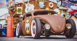 Old rusty car converted to a modern racing car. Meeting of bikers Burapa, Pattaya. royalty free stock image