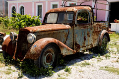 Old rusty car. In the courtyard of the house royalty free stock photography