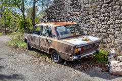 Old rusty car in croatian village. stock photos