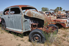 Old rusty car without an engine Royalty Free Stock Images