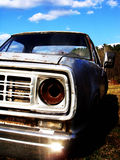Old rusty car in the field. Close up of old rusty car left in the field Stock Photography