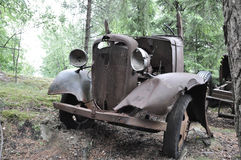 Old rusty car. In the forest, summer in Sweden Stock Image