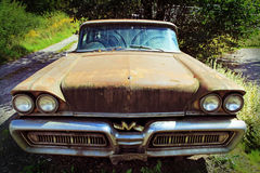 The old rusty car. An old Mercury from the USA Stock Photography