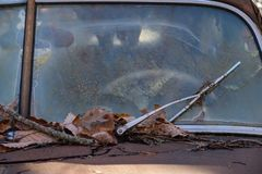 Windshield of an old abandoned car royalty free stock photography