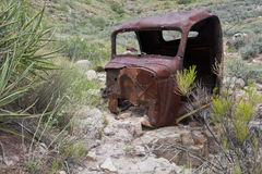 Old rusty car/truck in desert Stock Photo