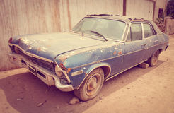 Old rusty car. Old vintage rusty car abandoned in a desert town royalty free stock photography