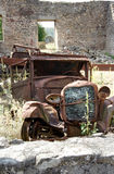 Old rusty car wreck. Abandoned and rusty old car wreck in a derelict building Royalty Free Stock Image