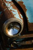 Old, rusty car wreck front and lamp detail royalty free stock photos