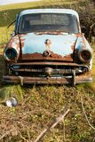 Old, rusty car wreck front and lamp, outdoor stock image