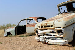 Old and rusty car wreck at the last gaz station before the Namib Royalty Free Stock Photos