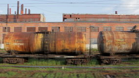 Old rusty cargo train, view from another train window