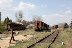 Old rusty cars standing in the abandoned depot. On background of blue sky Royalty Free Stock Photography