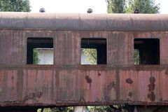 Old rusty cars standing in the abandoned depot. The locomotive stands on the rails Stock Images