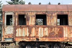 Old rusty cars standing in the abandoned depot. The locomotive stands on the rails Stock Photography