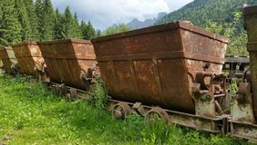 Old rusty carts for transporting materials from the mine. Schilpario, Bergamo, Italy stock photo