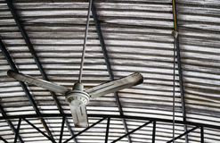 Old rusty ceiling fan hang on warehouse ceiling. Royalty Free Stock Photography