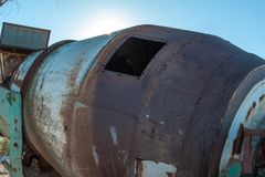 Old rusty cement mixer barrel stock photo