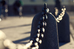 Old Rusty Chain Fence On The Street Under Sunshine Royalty Free Stock Image