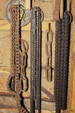 Old rusty chain hanging on the wall Stock Photo
