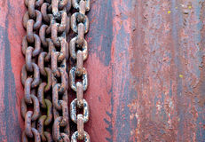 Old rusty chains on rotor Royalty Free Stock Photo