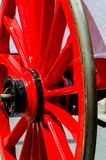 Old rusty circle wheel detail with a wagon, a traditional element of an old Spanish cart. Vintage stock photos