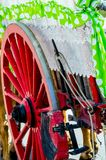 Old rusty circle wheel detail with a wagon, a traditional element of an old Spanish cart. Vintage royalty free stock photography