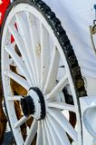 Old rusty circle wheel detail with a wagon, a traditional element of an old Spanish cart. Vintage stock photography