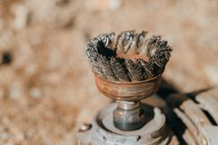 Old and rusty circular wire brush. Stock Photo