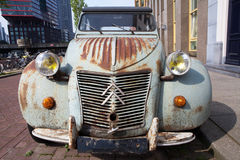 Old rusty citroen 2cv in the city Royalty Free Stock Photography