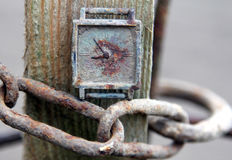 Old rusty clock on a chain Stock Image