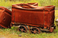 Old rusty coal wagon. In old mine Royalty Free Stock Images