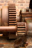 Old rusty cogs. Photograph of old rusty cogs on a machine Stock Photos