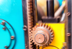 Old Rusty Cogs spinning for heavy industry Royalty Free Stock Photography