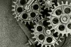 Old rusty cogs and wheels on rusty background Royalty Free Stock Image