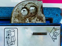 Old rusty coin slot close-up detail of street pay phone stock image