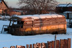 Old rusty and collapsed bus shrouded in snow. Royalty Free Stock Photo