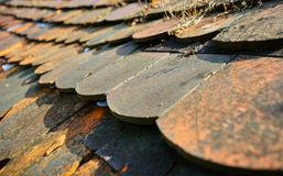 Old Rusty Colored Very Old Tile Roof - Close up stock images
