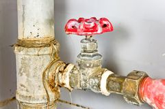 Old rusty colorful red brass valve with tubes. Stock Image