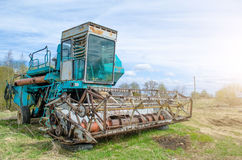 Old rusty combine harvester equipment in an abandoned collective farm. Royalty Free Stock Photos