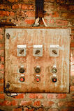 An old rusty control panel on the wall Royalty Free Stock Photo