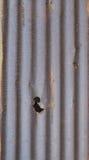 Old rusty corrugated tin zinc metal wall Royalty Free Stock Photo
