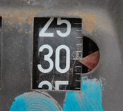 Old rusty counter on gasoline out damaged pump Royalty Free Stock Images