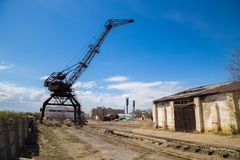 Old Rusty Crane In Abandoned Industrial Area. Stock Photography