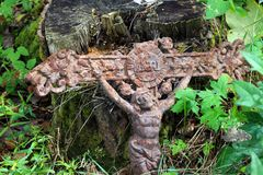 Old rusty cross lost in the woods Royalty Free Stock Photo