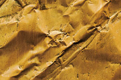Old rusty crumped metal in gold color. Old rusty crumped metal in gold yellow color Royalty Free Stock Images
