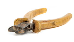 Old rusty cutter. On the white Stock Photos
