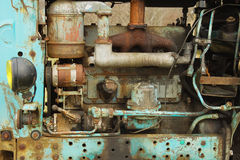 Old rusty diesel. Engine of old rusty tractor Stock Photos