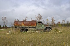 Old rusty dilapidated water truck Stock Photo