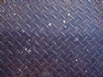 Old rusty dirty blue iron steel checker plate Royalty Free Stock Photos