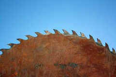 Old rusty disk. From a circular saw against the sky Stock Photo